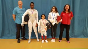 Teagan, Khalam and Georgia with their medals