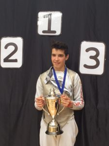 Benjamin with his trophy after winning gold in U16 boys