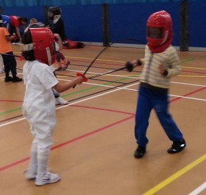 Two mini-fencers duel