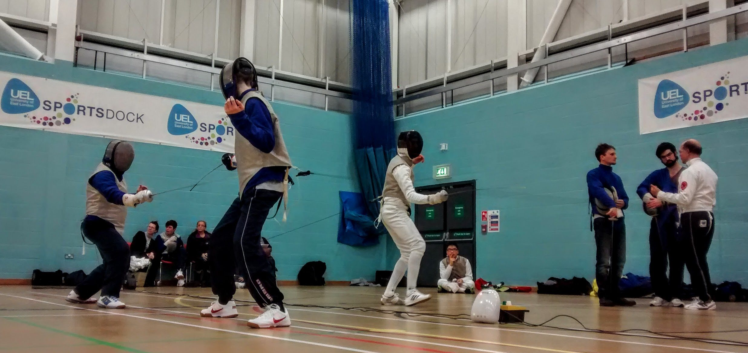 Pictures of fencers and coach