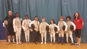 Newham U11 and U13 foil teams. Both took bronze at the Finchley Foil event in April 15. (Left to right) - Pierre Harper, Teagan Williams-Stewart, Jacob Haynes, Keir Adeleke, Alek Matvjev, Sophie Tsang, Tom Myers, Omar Dig and Linda Strachan. Jamiel Contractor (U11 Team) could not make the photo.