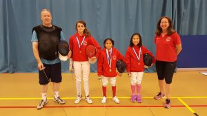 Pierre and Linda with the medalists of LPJS Newham, (from left) Georgia, Khalam and Sofie.