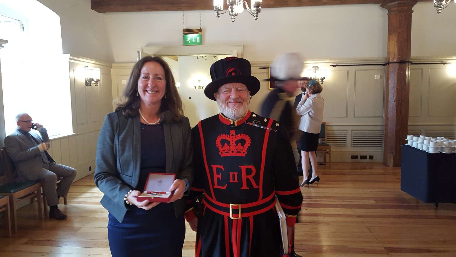 Linda with medal and Beefeater