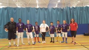Pierre (left) and Linda (right) with the Newham fencers who represented the club at the London Youth Games.