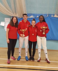 Benjamin Urdrzal, Emilia Lukaite and Teagan William-Stuart with coach Linda Strachan