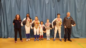 Linda and Pierre with Newham Swords fencers and their trophies.