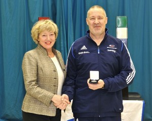 Pierre Harper receiving his British Fencing Silver medal from BF President, Hilary Philbin