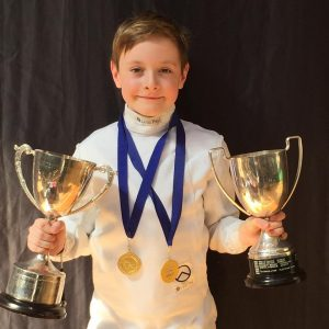 Tomi with AYC trophies