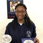Teagan Williams-Stuart with the foil team and individual trophies