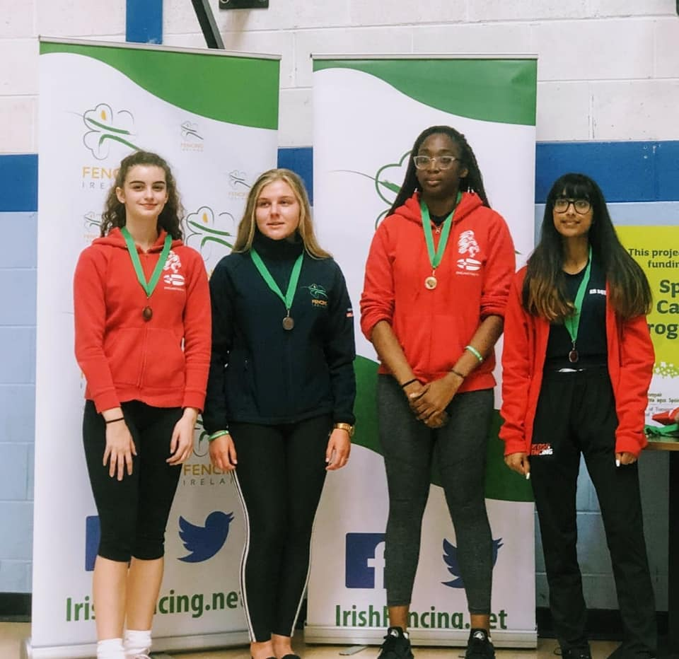 Georgia Silk (Left) taking Bronze and Teagan Williams-Stewart (2nd Right) taking Gold for England in the individual event